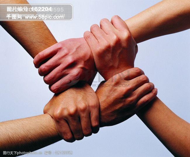 手合作团结时间动作握手球概念寓意图片